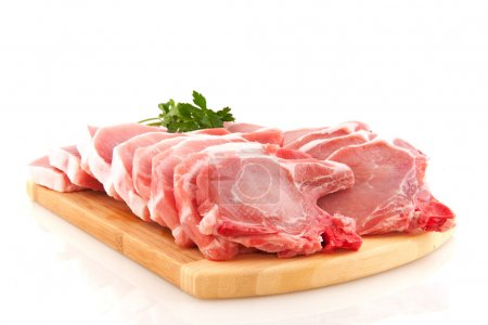 Many fresh pork chops or cutlets with parsley...