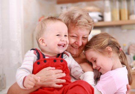 Photo for Cute little boy and little girl happy with grandmother - Royalty Free Image