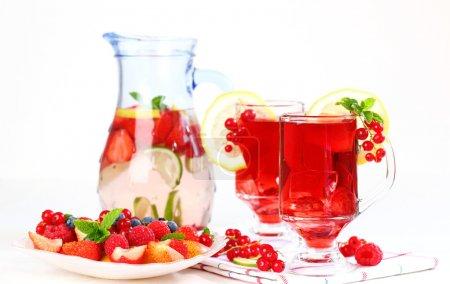 Refreshing summer ice tea with fresh fruits