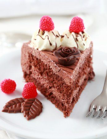 Photo for Delicious chocolate cake garnished with fruits - Royalty Free Image