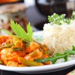 Red chicken curry stripes with rice and vegetable...