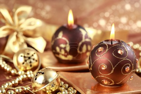 Photo for Christmas still life with candles and jingle bells in brown and golden tone - Royalty Free Image