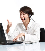 Woman operator with headset showing OK