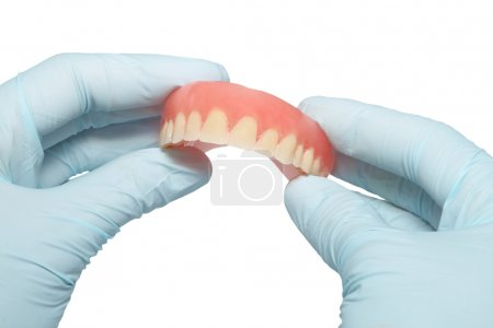 Photo for Demountable tooth prostheses in hands of the dentist - Royalty Free Image