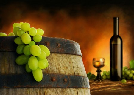 Photo for Wine barrel, bottle and glass with fresh grapes on cellar background - Royalty Free Image