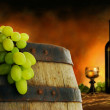 Wine barrel, bottle and glass with fresh grapes on...