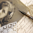 Vintage memories with photo of lovely girl, pen an...