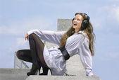 Happy girl is listening music