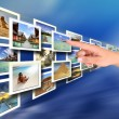 Woman hand choosing a holiday from digital wall wi...