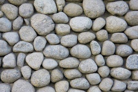 Photo pour Mur de pierre naturelle de rivière / granit - image libre de droit