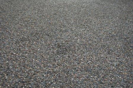 Photo pour Une texture de fond de perspective d'asphalte rugueux - image libre de droit