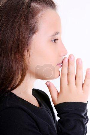 Photo pour Profil de fille Beuaty priant sur fond blanc - image libre de droit