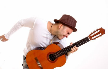 Photo for Man playing acoustic guitar on white background - Royalty Free Image
