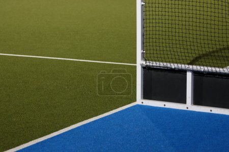 Abstract view of hockey goals on an Astroturf play...