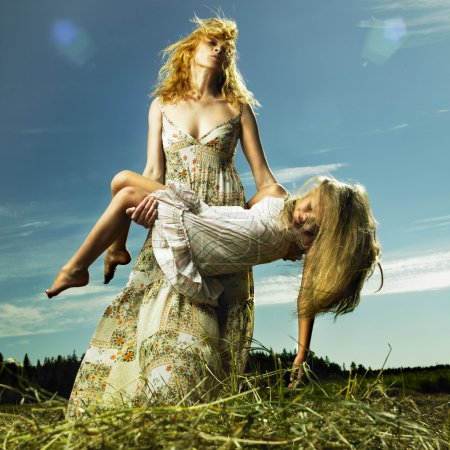 Photo for Mother and daughter having fun on field - Royalty Free Image