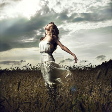 Photo for Portrait of jump women in wheat field - Royalty Free Image