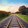 Railway tracks in a rural scene with nice pastel s...