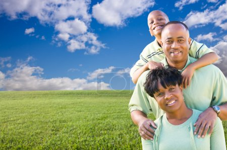 Happy African American Family Over Grass