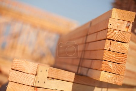 Stack of Building Lumber at Construction Site with...