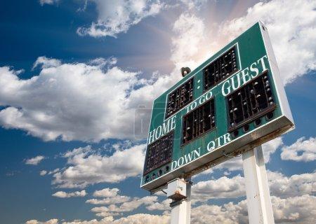 HIgh School Score Board on Cloudy Sky