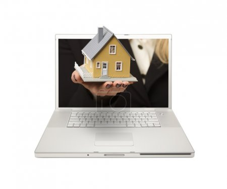 Woman Handing House Thru Laptop Screen