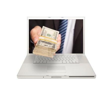 Businessman Handing Stack of Money Through Laptop ...