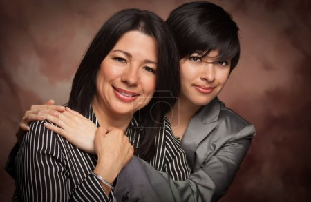 Attractive Multiethnic Mother and Daughter Studio Portrait on a Muslin Back