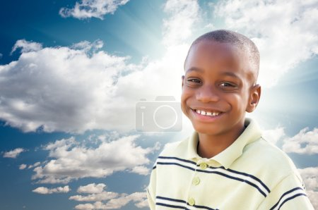 Young African American Boy with Clouds and Sky