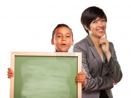 Hispanic Boy Holding Chalk Board and Female Teacher Behind