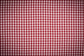 Red and White Gingham Checkered Tablecloth Background with Vigne