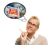Woman with Thought Bubbles of a Sold Real Estate Sign