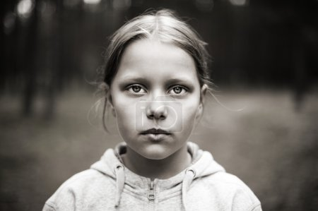 Photo for Black and white portrait of tired little girl with sad eyes. Shallow DOF - Royalty Free Image