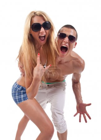 Photo for Party couple screaming against a white background - Royalty Free Image