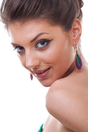 Model wearing colorful earrings