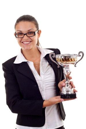 Business woman winning a trophy