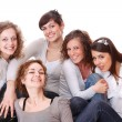 Group of happy pretty laughing girls over white ba...