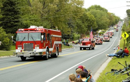 Photo for Fire and rescue vehicles being driven in a fire muster parade. - Royalty Free Image
