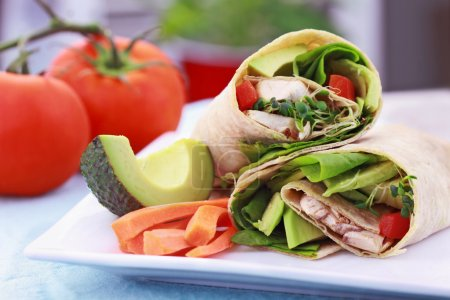 Photo for Vegan sandwich wrap with Lavish bread made from flax, oats and whole wheat. Stuffed with fresh spinach, sprouts, mushrooms, red peppers and avocados for a healt - Royalty Free Image