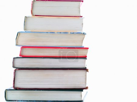 Photo for Old Textbooks stacked on a blank background - Royalty Free Image