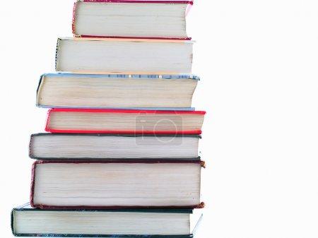 Photo pour Vieux manuels empilés sur un fond vierge - image libre de droit