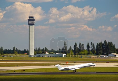 Air Traffic Control Tower and an Airplane Taking