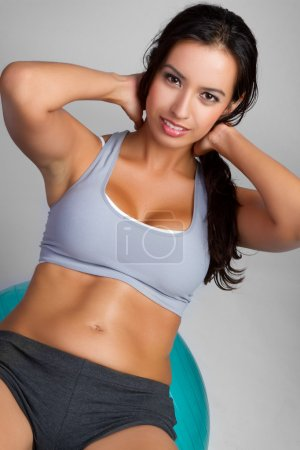 Photo for Beautiful latin fitness woman exercising - Royalty Free Image