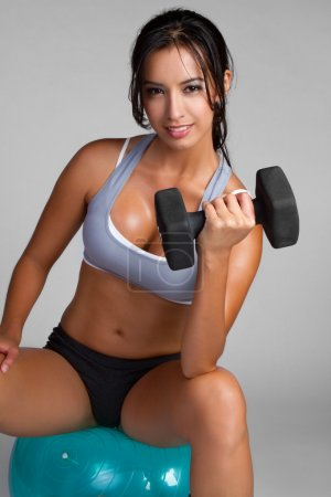 Photo for Happy young fitness woman exercising - Royalty Free Image