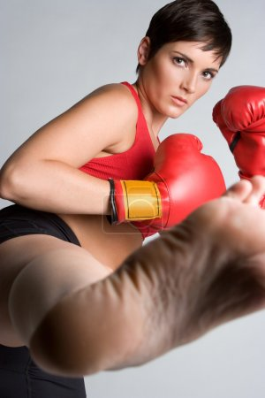 Photo for Beautiful athletic kickboxing woman kicking - Royalty Free Image
