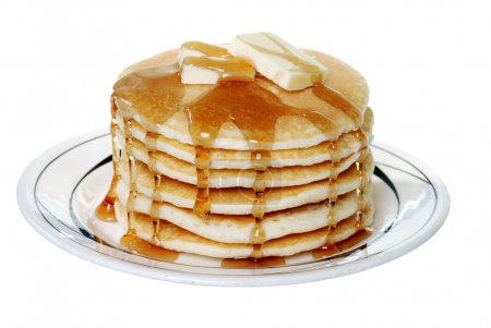 Isolated pancakes with butter and syrup on white background