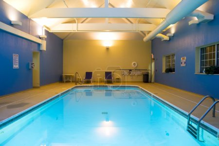 Photo for Wide angle view of an indoor swimming pool in a hotel - Royalty Free Image