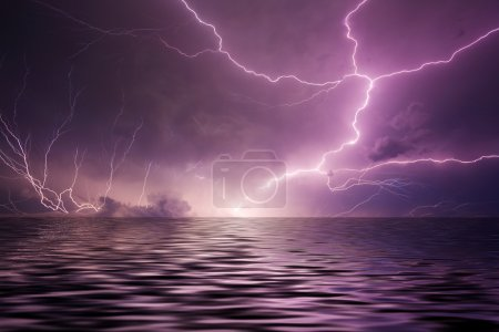 Photo for Multiple lightning bolts reflected in the open sea - Royalty Free Image