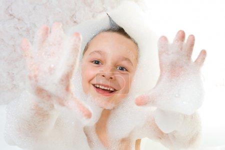 Child playing with shampoo foam
