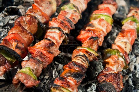 Barbecue with delicious grilled meat on