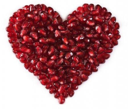 Heart shaped pomegranate seeds, high key